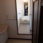 Washroom changing area and bathroom.